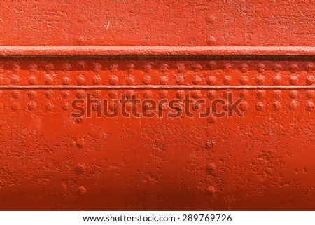 Old ships hull texture, red metal wall texture with seams and rivets - stock photo
