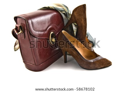 old shoes and bag on white background isolated - stock photo