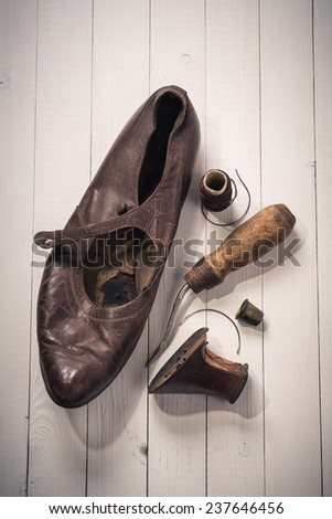 Old shoes and recovery tools. Top view - stock photo