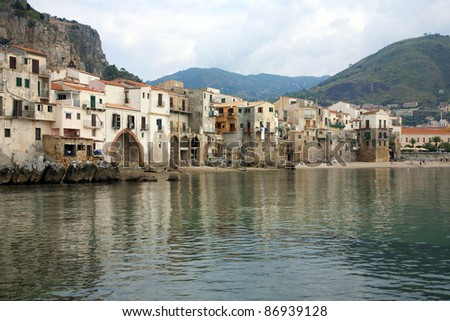 Old Sicilian city of Cefalu of the coastal Terensky sea - from port. - stock photo