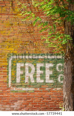 """Old sign """"Free Service""""  painted on a brick wall of a building on main street in Yoncalla Oregon - stock photo"""