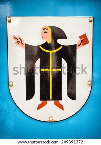 old sign of the munich kindl - the coat of arms of munich - germany - stock photo