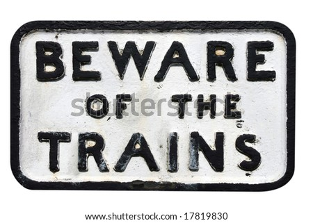 Old sign on railway track warning of trains - stock photo