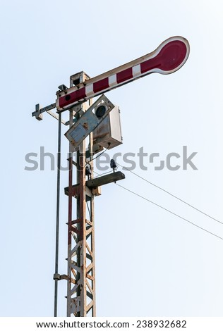 Old signal pole in the railway station. - stock photo