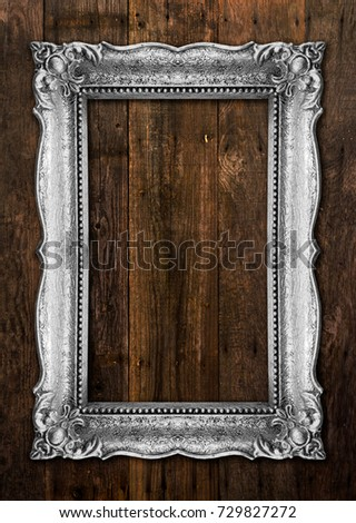 Old Silver Picture Frame on wood background