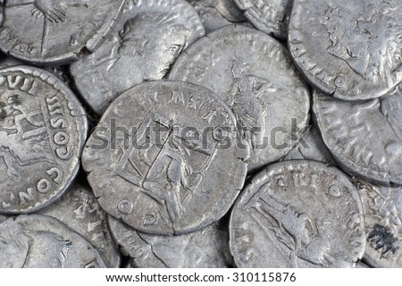 old silver roman coins background - stock photo