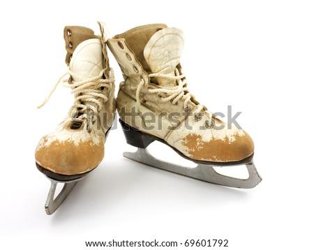 Old skates on a white background. - stock photo