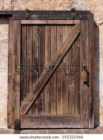 Old sliding wooden door rustic texture - stock photo
