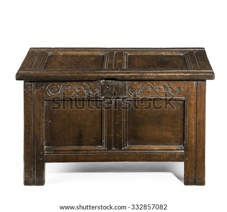 Old small coffer chest trunk early made from oak with detail carving and metal lock isolated with clipping path - stock photo