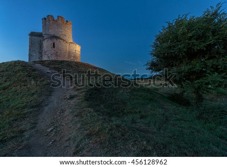Old small stone church of St. Nicholas on hill near city of  Nin in Croatia