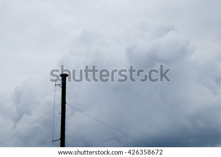 old  smokestack factories on cloudy background