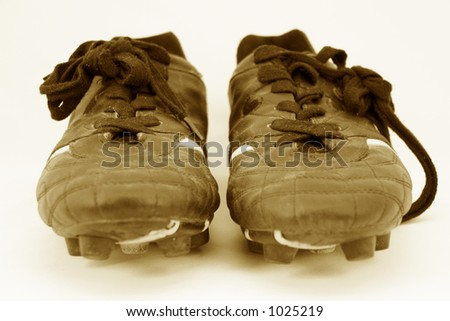 old soccer boot cleats 2 - stock photo