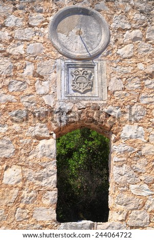 Old solar clock on a wall of Venetian building on Dalmatian coast, Croatia - stock photo