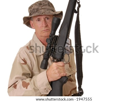 old soldier with sniper rifle dressed in desert camouflage