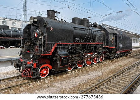 Old soviet steam locomotive series SO at railway station. - stock photo