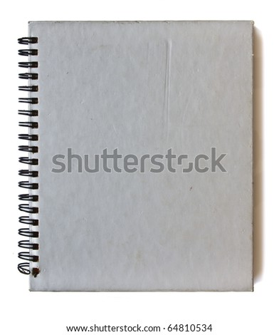 Old spiral gray notebook on white background - stock photo