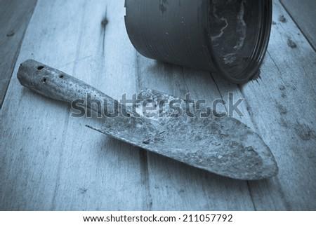 old spoon shoveling Black plastic pots,vintage - stock photo