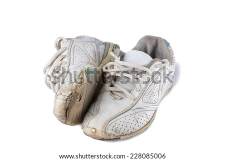 Old sport shoes isolated on white - stock photo