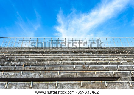 old sport stadium and clear blue sky - stock photo