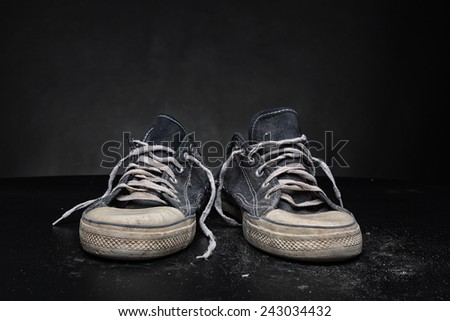 Old sports trainers - stock photo