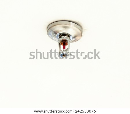 Old sprinkler system on the ceiling of home office. - stock photo