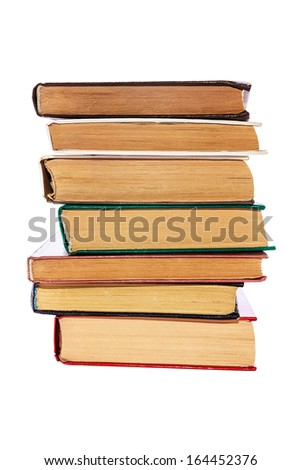 old stacked books isolated - stock photo