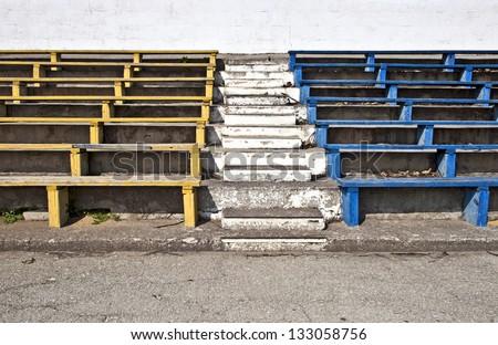 Old stadium benches - stock photo