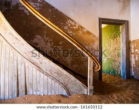 Old staircase in Kolmanskop ghost town (Namibia) - stock photo