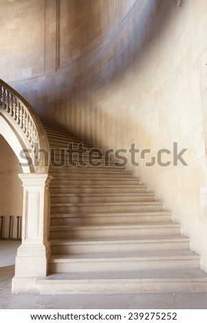 Old staircase made of pure white marble - stock photo