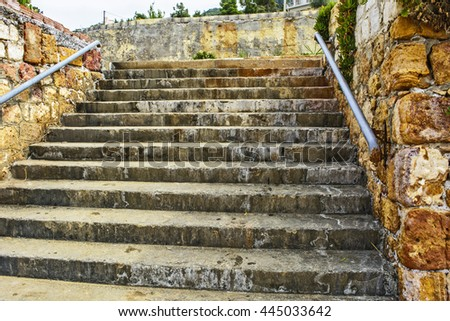 Old stairs in the littoral town where you can see the effect of salt in the air. - stock photo