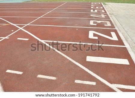 old starting line on a red running track
