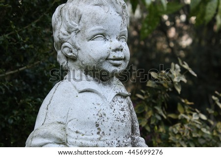 Old statue of a little boy
