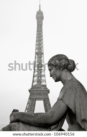 Old statue with Eiffel Tower in the background in Paris, France, Classic Romantic view - stock photo