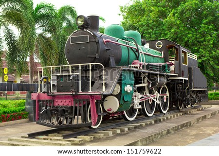 Old steam engine - stock photo