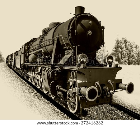 Old steam engine locomotive isolated on background. Clipping path. - stock photo