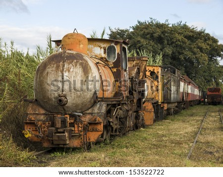 Old steam train sitting in the yard rusting away - stock photo
