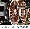 Old steam train wheel - stock photo