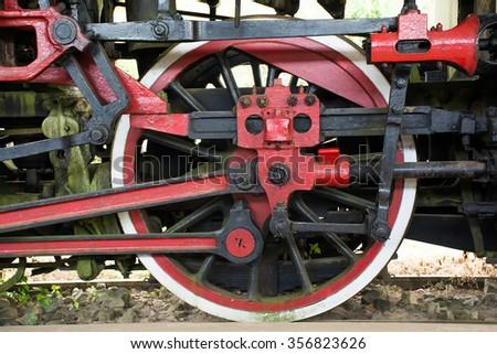 Old steam train wheel, Vietnam. - stock photo