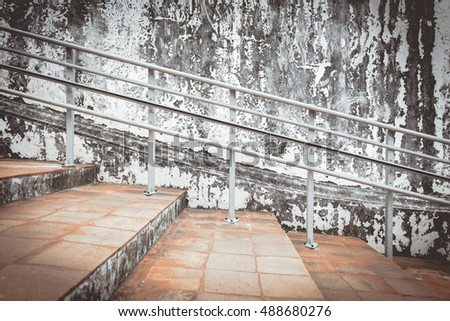Old Steel banisters and old cement wall cracks with paint peeling