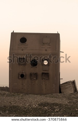 Old steel bunker equipment, which determines strength of shock wave, light radiation, radioactivity during nuclear explosion. the Novaya Zemlya archipelago, Russia - stock photo