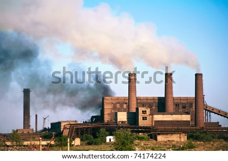 Old steel factory. Smoke. Environmental pollution and global warming. - stock photo