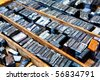 old steel fonts in wooden case, many letters, shallow depth of field - stock photo