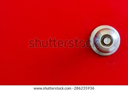 old steel handle on red wood door with noise texture - stock photo