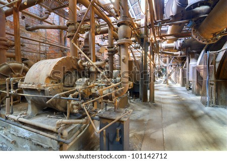 Old steel mill machinery - stock photo