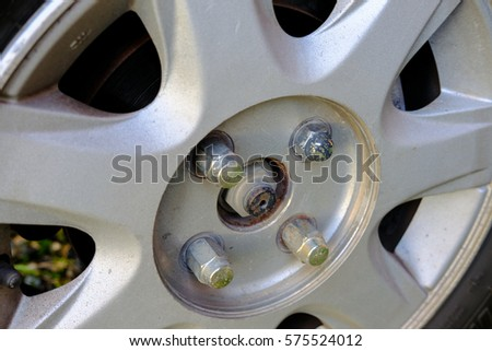 car close up details with chrome hubcaps old steel wheels selective focus and close up image