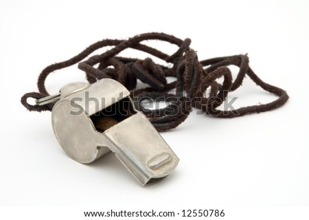 old steel whistle isolated on white background