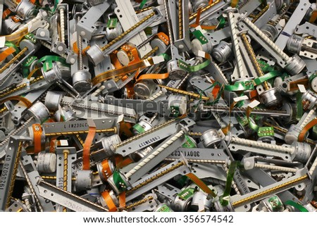 Old stepper motors from floppy and cd dvd drives. Technology electronics waste as background. - stock photo