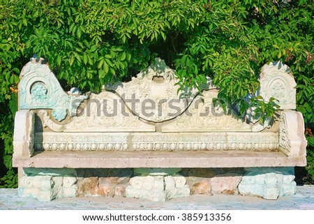 Old Stone Bench in the Garden - stock photo