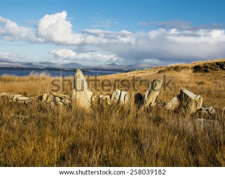 Old stone boundary on the Sheeps Head peninsular in West Cork, Ireland. Showing Bantry Bay and the Cork and Kerry Mountains. - stock photo