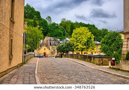 Old stone bridge in Luxembourg in Benelux, HDR - stock photo